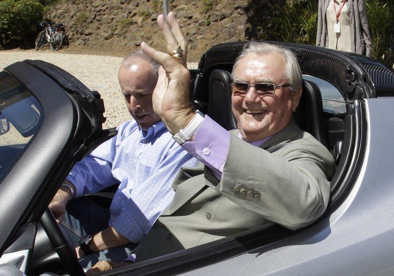 Prince Henrik, right, drives a Tesla Roadster in Palo Alto, California in June 2011.