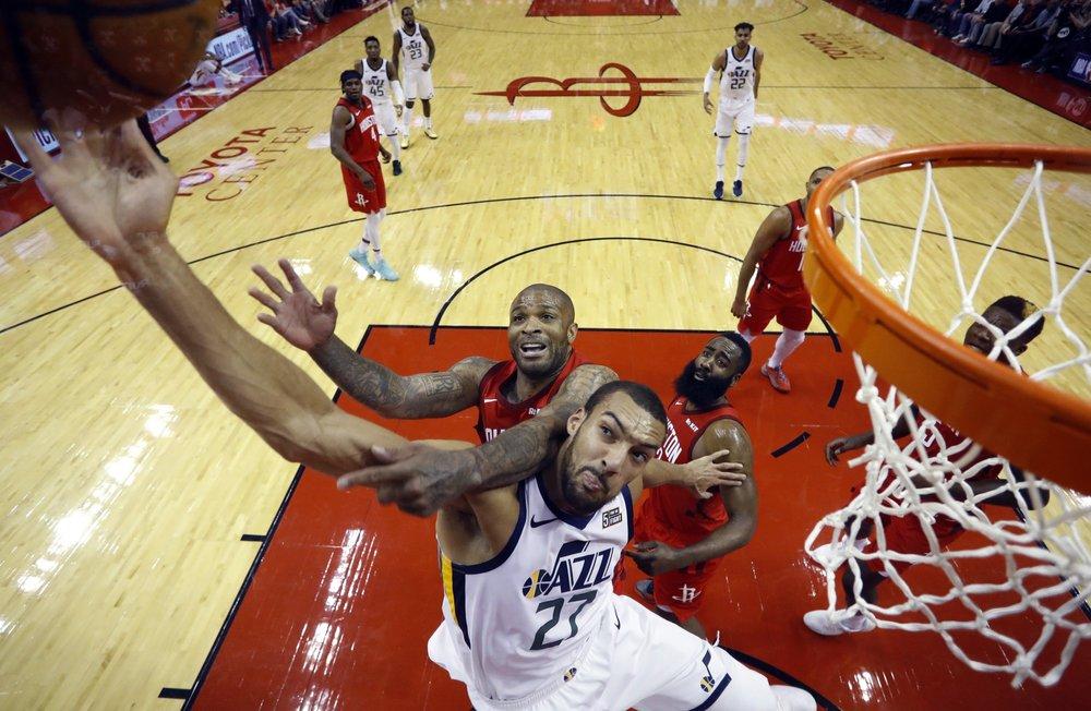 Utah Jazz center Rudy Gobert (27) is fouled by Houston Rockets forward PJ Tucker (17) as he tries to score. (AP photo)