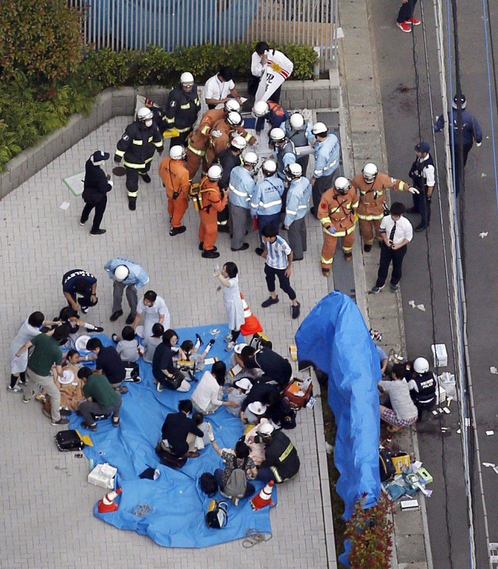 http://www.thestandard.com.hk/breaking-news/section/4/128632/School-girl-killed-in-Tokyo-mass-stabbing,-13-children-wounded