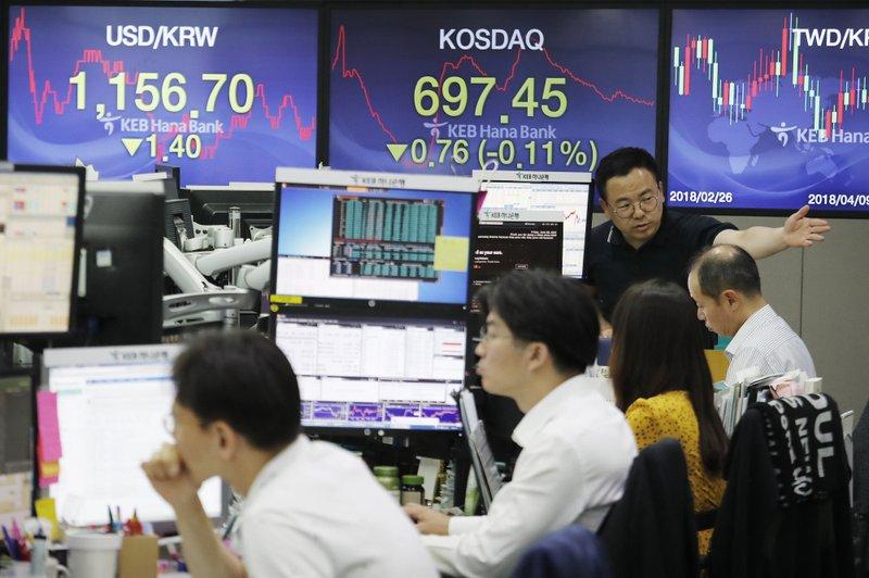 Nikkei closes lower