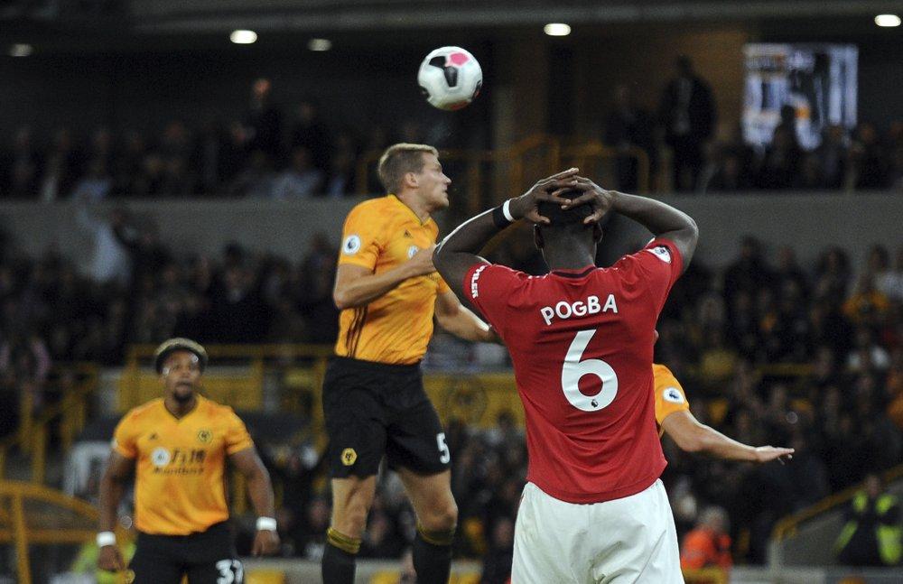 Manchester United's Paul Pogba, front, fluffs a spot kick.