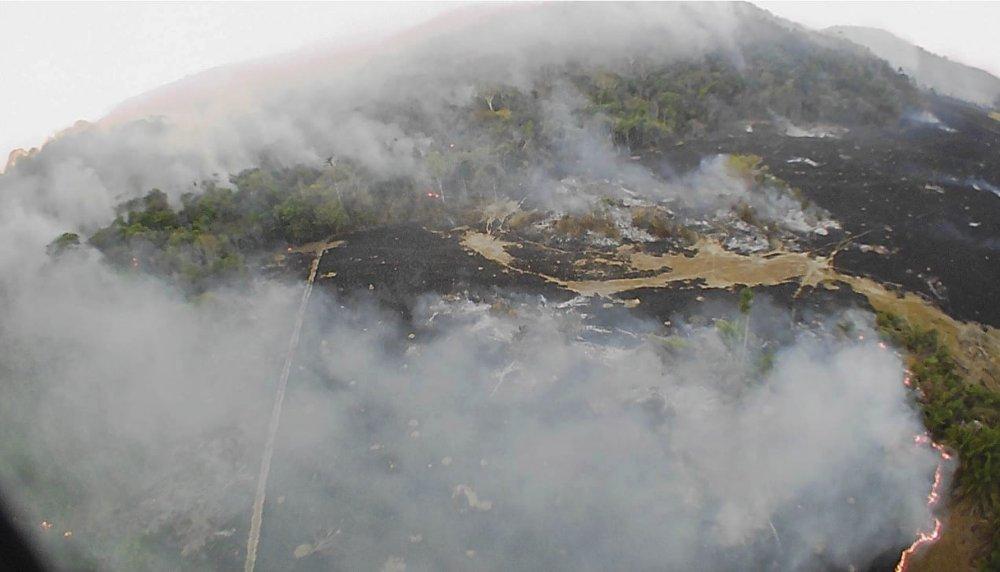 In this August20, drone photo released by the Corpo de Bombeiros de Mato Grosso, brush fires burn in Guaranta do Norte municipality, Mato Grosso state, Brazil.