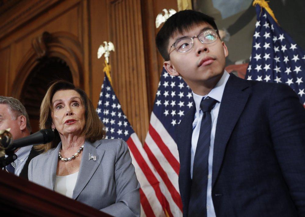 US House Speaker Nancy Pelosi, left, with Hong Kong activist Joshua Wong. (AP photo)