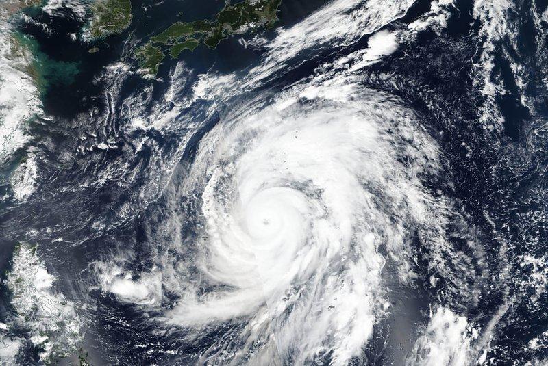 Photo taken by NASA-NOAA's Suomi NPP satellite shows typhoon Hagibis approaching Japan, top. (via AP)