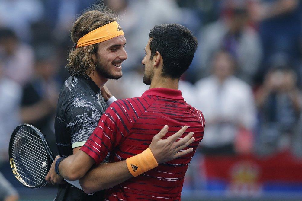 Stefanos Tsitsipas, left, of Greece is congratulated by Novak Djokovic of Serbia. (AP photo)