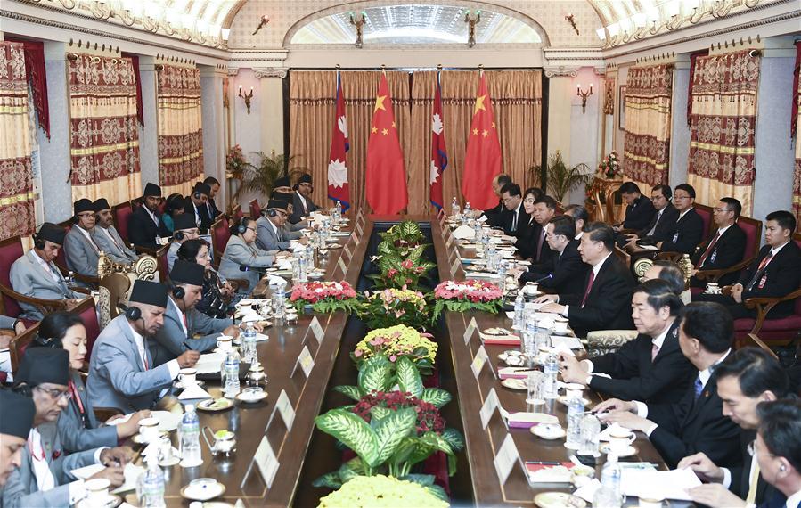 President Xi Jinping meets with Nepali President Bidya Devi Bhandari in Kathmandu, Nepal, on October 12.