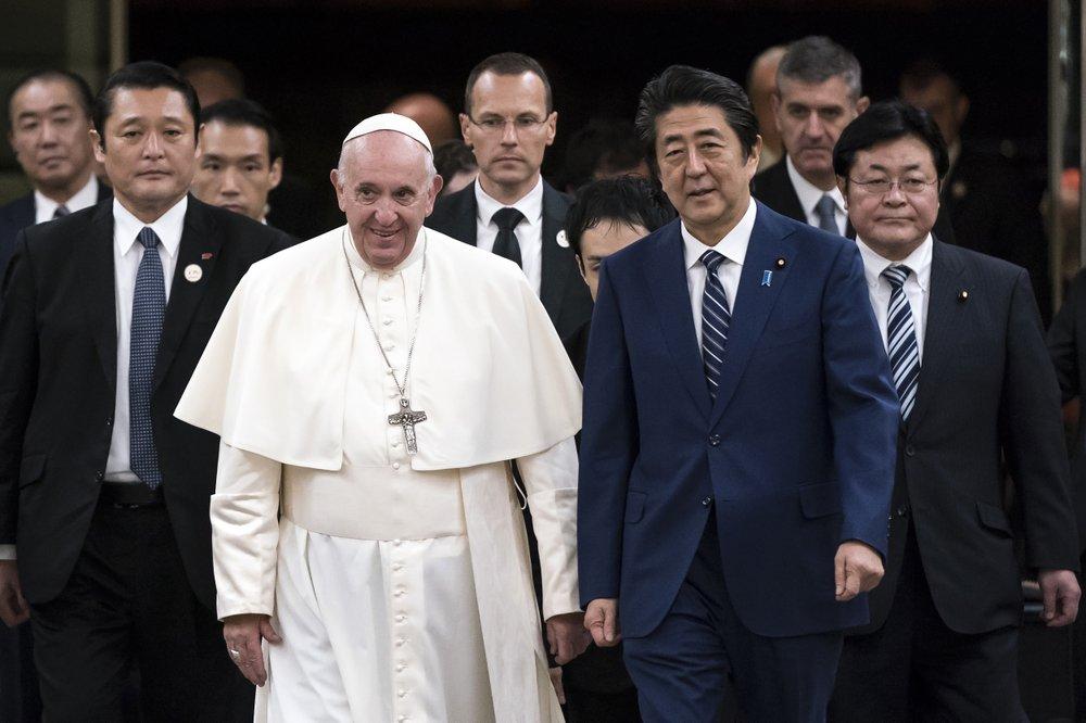 Pope Francis walks with Japan's Prime Minister Shinzo Abe. (Pool Photo via AP)