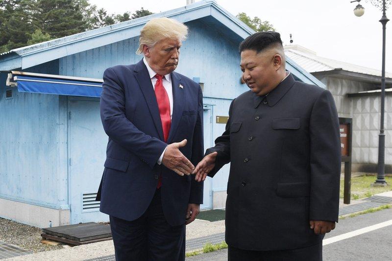 File photo shows U.S. President Donald Trump, left, and North Korean leader Kim Jong Un.