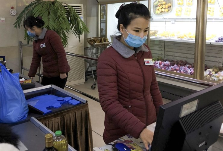 Supermarket staff at the Munsu-dong diplomatic compound in Pyongyang, North Korea.