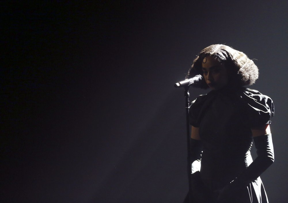 Celeste wins the rising star award at the Brit Awards. She sang the ballad Strange.