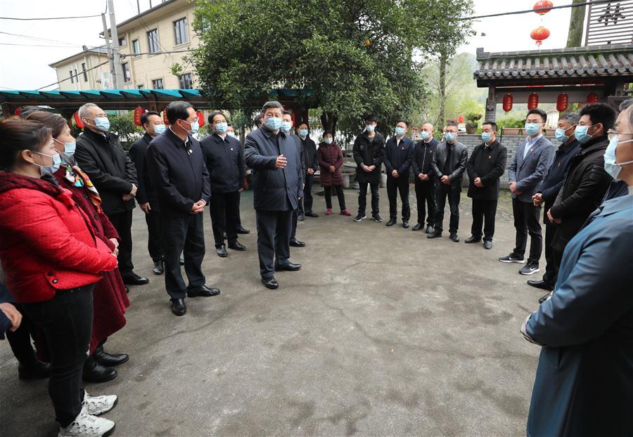 President Xi Jinping, with villagers in Yucun in theTianhuangping township in Anji county, in eastern Zhejiang province.