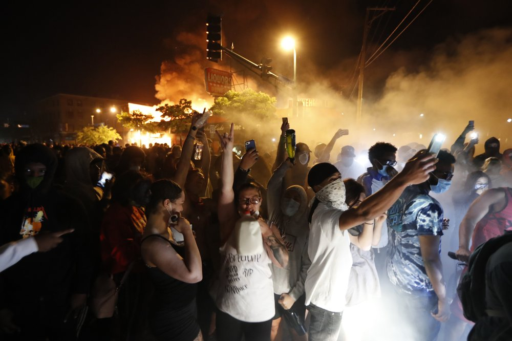 Protesters enraged by death of black man in US set police station ablaze