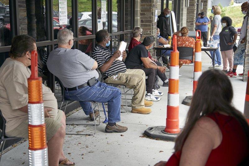 Job seekers wait to be called into the Heartland Workforce Solutions office in Omaha, Nebraska in July.