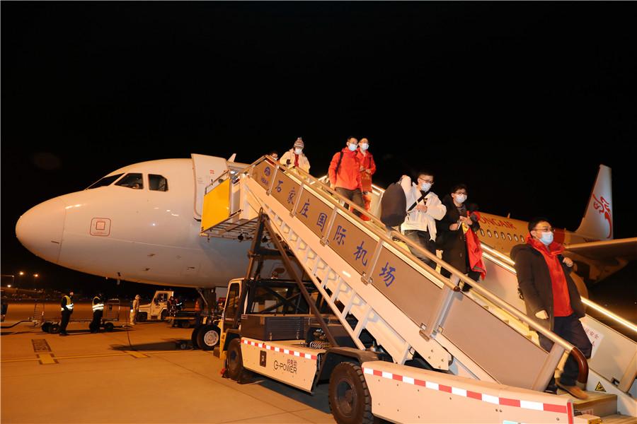 Medical workers from Jiangsu and Zhejiang provinces arrive at Shijiazhuang Zhengding International Airport in Shijiazhuang, Hebei province, on January 7, 2021.