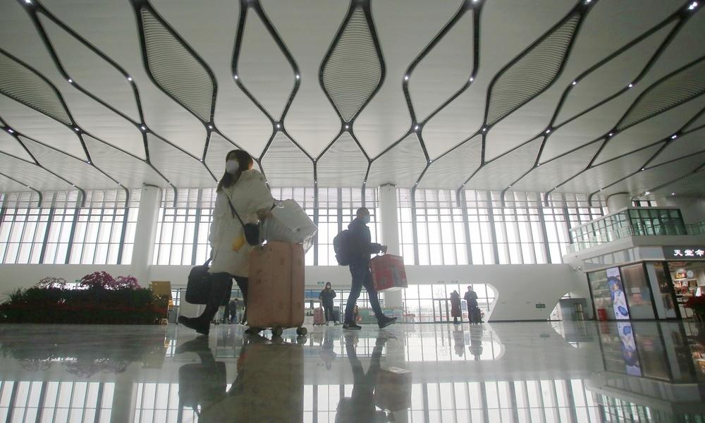 Passengers at Yangzhou East Railway Station in east China's Jiangsu province on Wednesday.