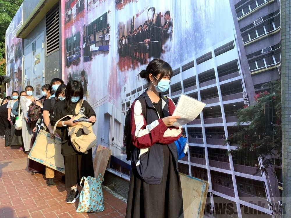 DSE exam candidates outside an exam centerataround 7:00am.