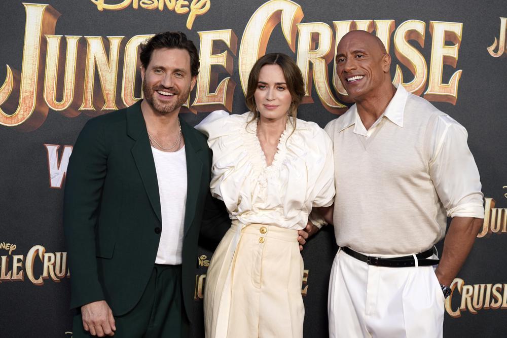From left, Edgar Ramirez, Emily Blunt and Dwayne Johnson, cast members in