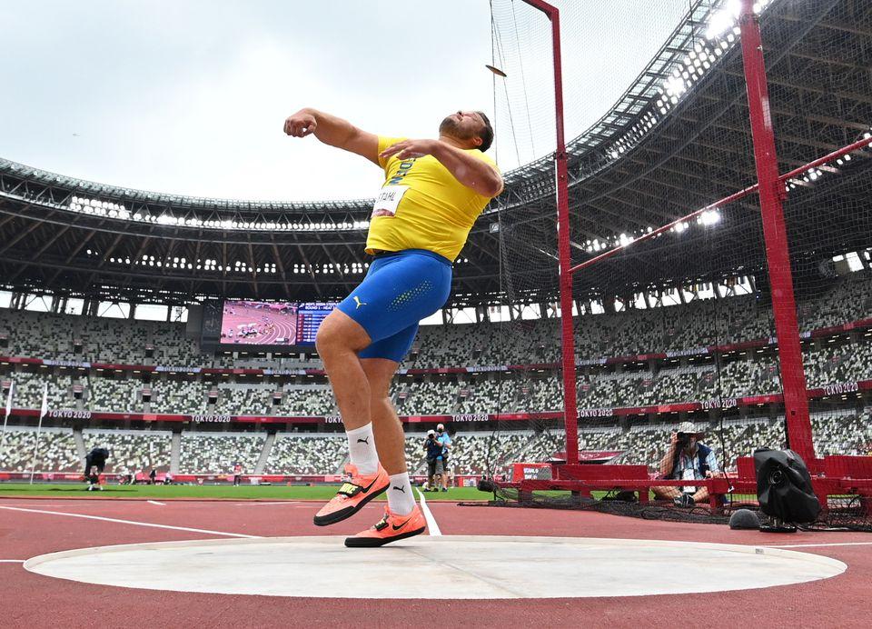 Sweden's world champion Daniel Stahl pulls off 66.12 meter throw.