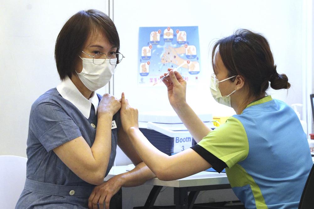 A nurse receiving a Covid-19 vaccination.