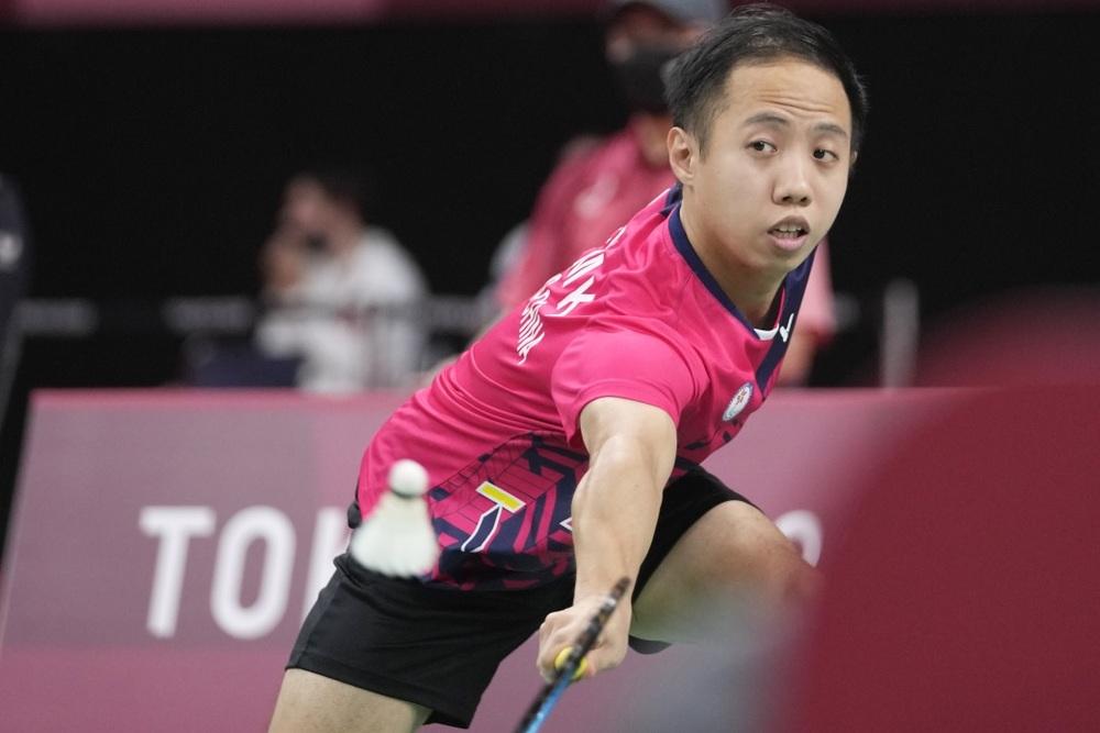 Hong Kong's Chu Man Kai competes against India's Krishna Nagar during men's singles SH6 gold medal badminton match (AP)