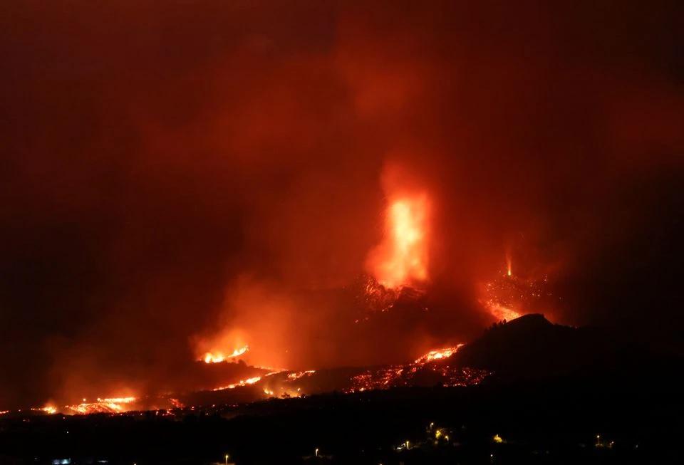 Lava and smoke rise following the eruption of a volcano on the Island of La Palma, in Los Llanos de Aridane, Spain.