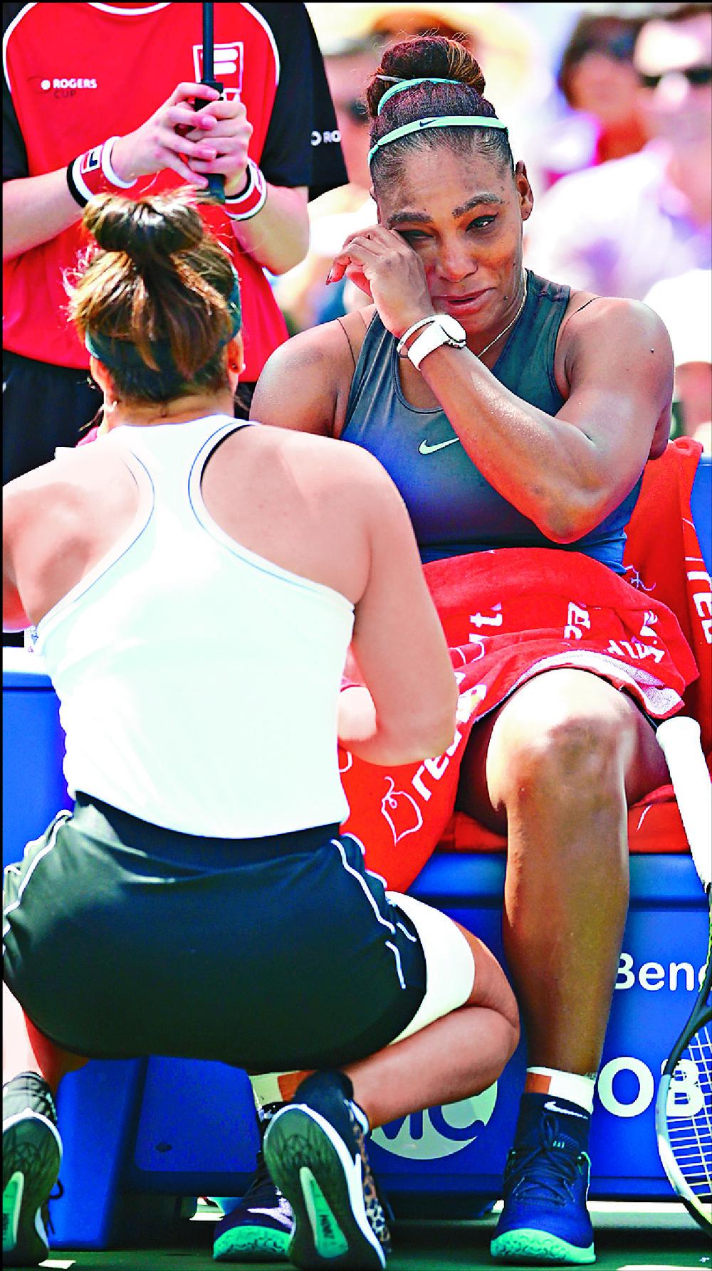 Bianca Andreescu comforts Serena Williams. AFP