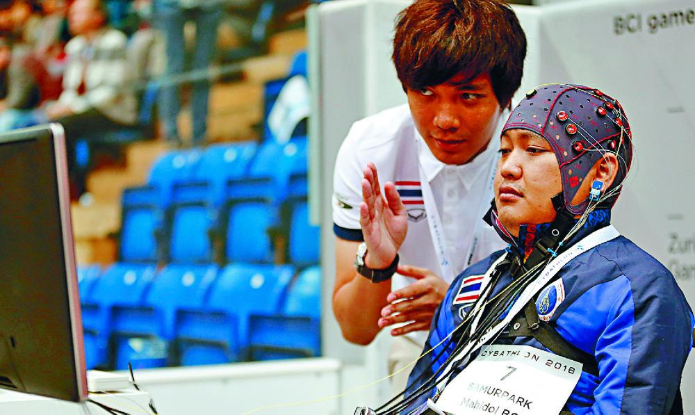 Thai competitors at a brain-computer interface race at the Cybathlon Championships in Switzerland. reuters/arnd wiegmann