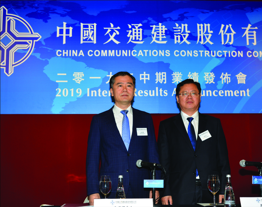 Zhou Changjiang, right, with general manager of finance and fund development Zhu Hongbiao. SING TAO