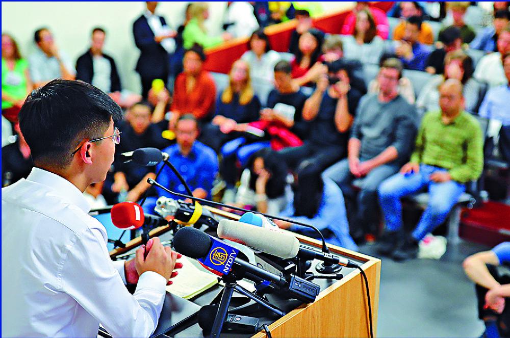 Joshua Wong speaks to students at Humboldt University in Berlin. Ken Wu says Heiko Maas' meeting with Wong sent very negative signals.REUTERS, AP