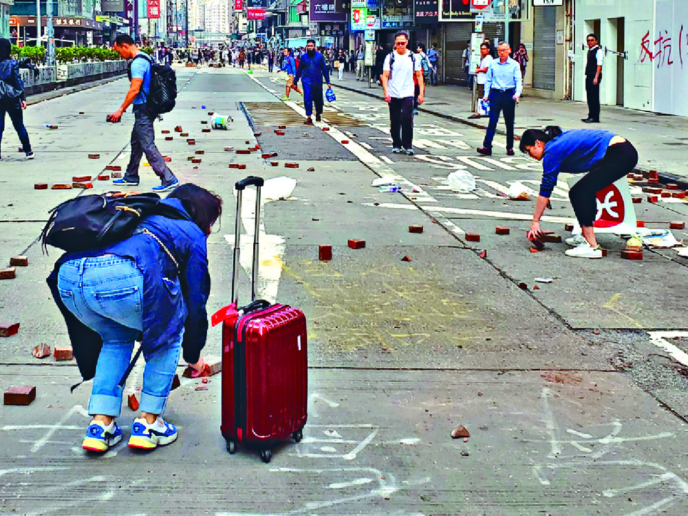 Volunteers clean up in Mong Kok and Tuen Mun.