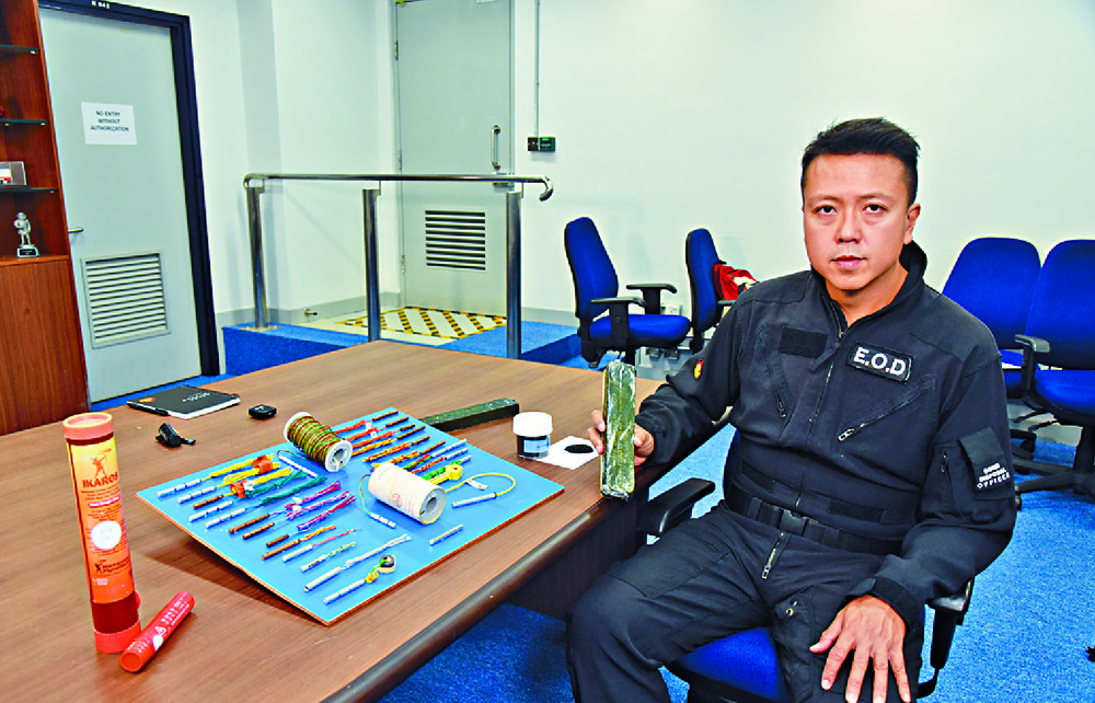 Suryanto Chin-chiu displays some of the seized bomb-making equipment.  Sing Tao