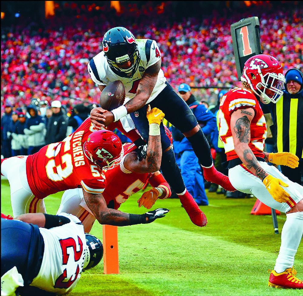 Texans quarterback Deshaun Watson leaps for a touchdown over the Chiefs' defense.  GETTY IMAGES