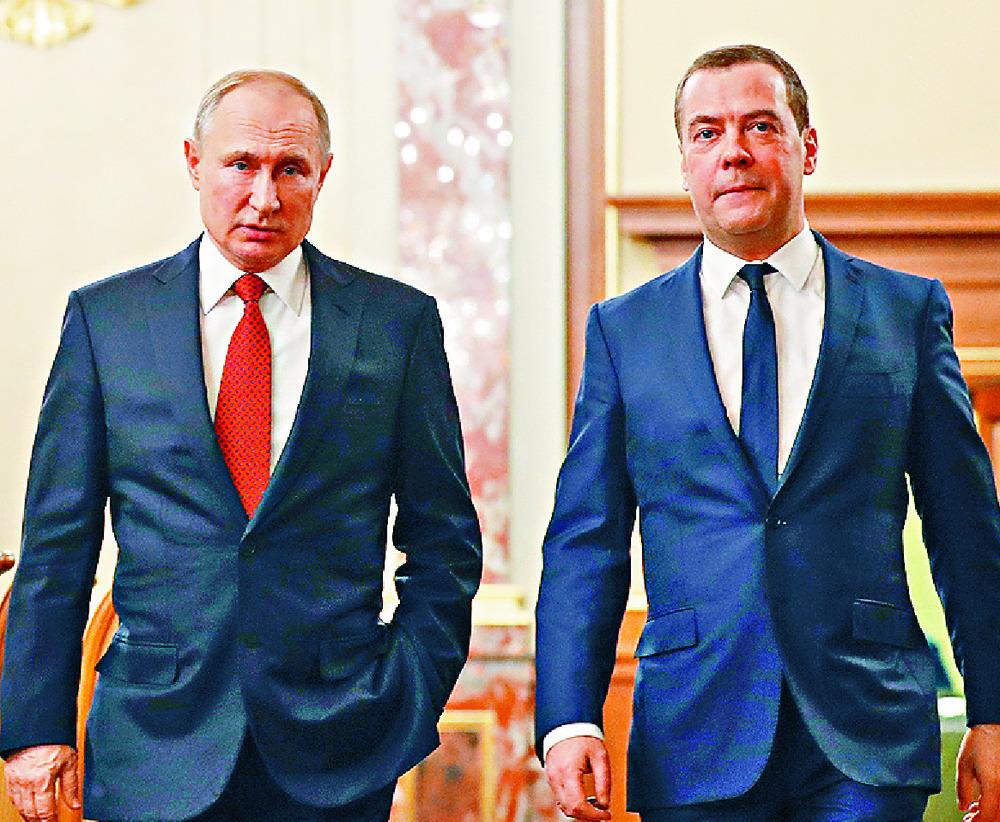 Dmitry Medvedev, with Vladmir Putin, has new job. AP