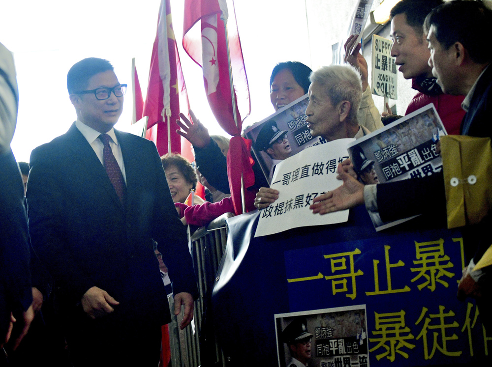 http://www.thestandard.com.hk/section-news/section/4/215671/Tang-says-ID-rap-on-cards-for-cops