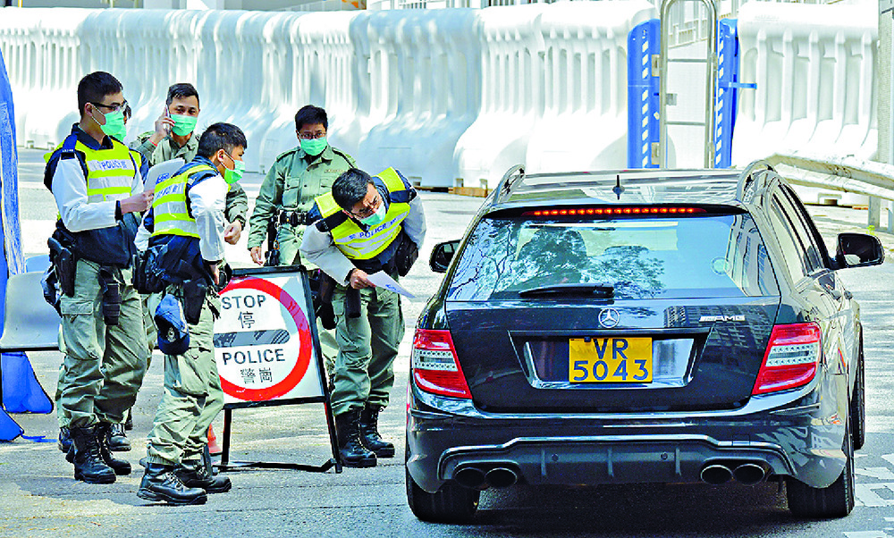Police check vehicles near the Chun Yeung estate.