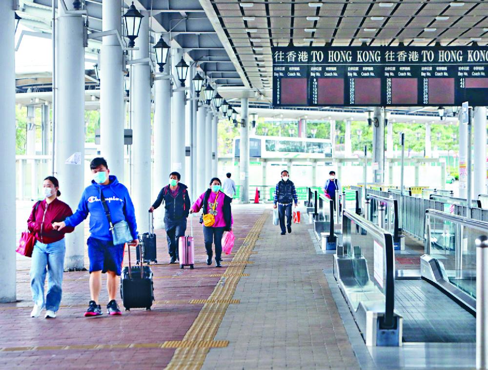 Travelers cross the border at Shenzhen Bay.