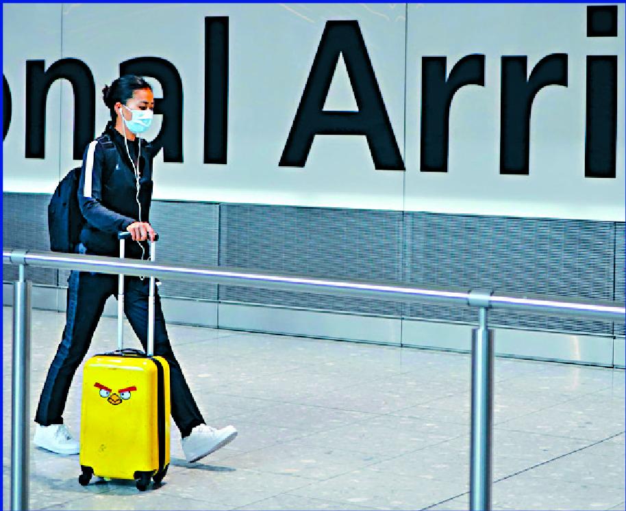 A passenger arrives at Heathrow Airport. AFP