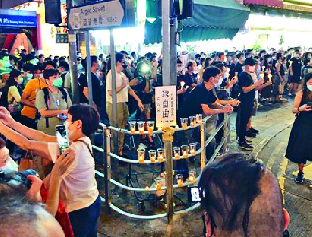 http://www.thestandard.com.hk/section-news/section/11/219713/Thousands-defy-vigil-ban