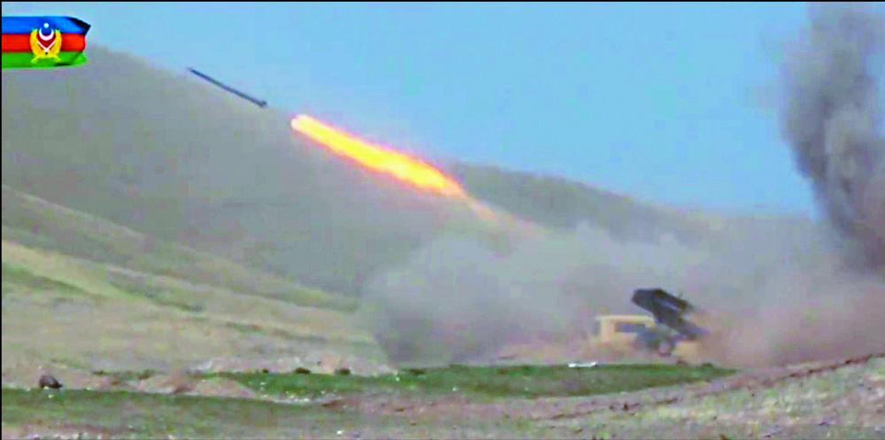 Azerbaijan troops conduct combat operations against Armenian separatists. AFP