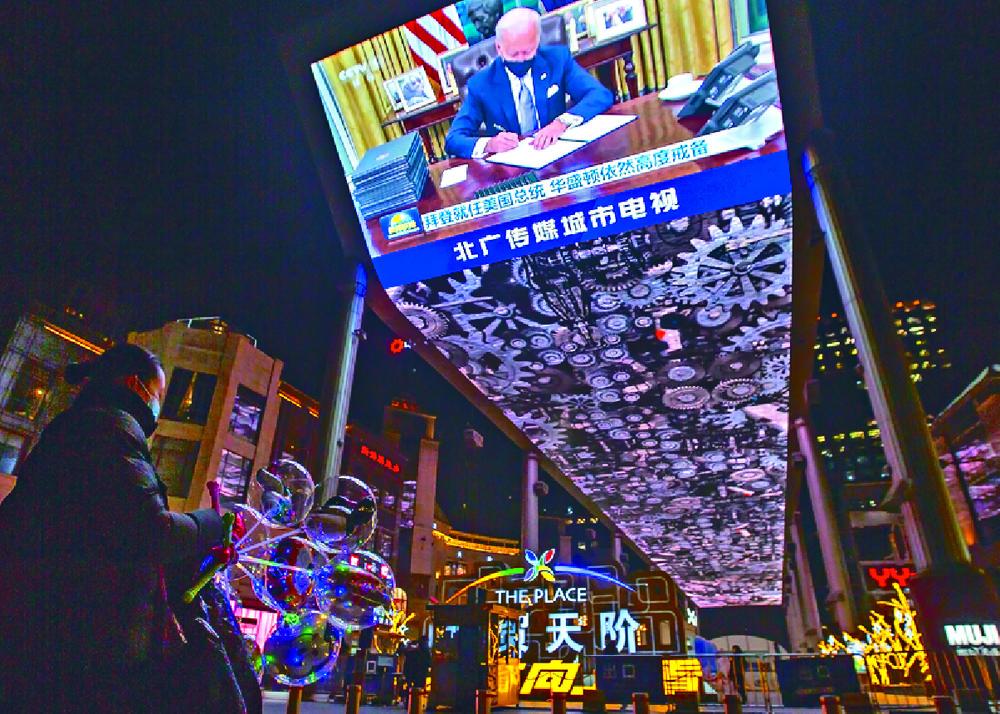 A large video display at a Beijing shopping mall shows Joe Biden's inauguration. AP