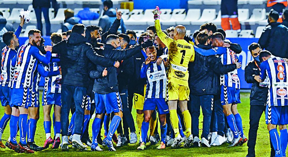 Alcoyano players celebrate beating Real Madrid.  AP