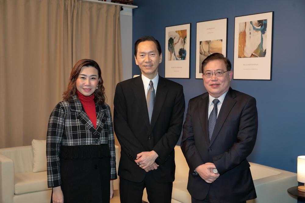 Bernard Chan, center.