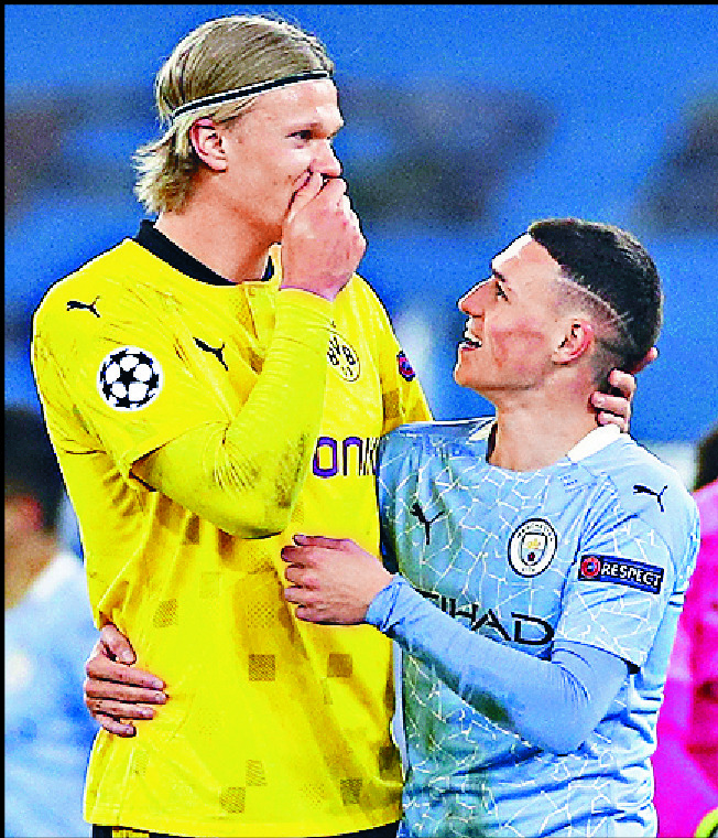 Phil Foden with Dortmund's Erling Haaland, left. REUTERS