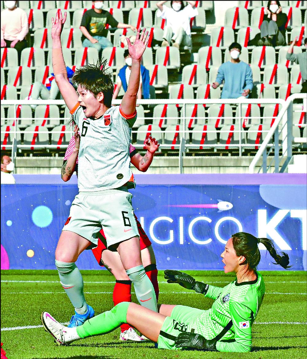 Zhang Xin celebrates scoring against South Korea 'keeper Kim Jung Mi.  AFP