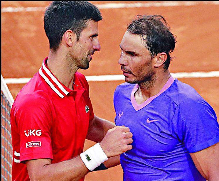 Novak Djokovic, left, congratulates Rafael Nadal on winning the final.  AP