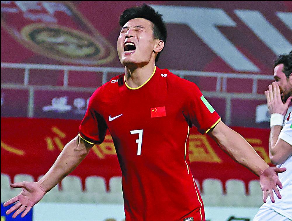 Wu Lei celebrates scoring against Syria. AP
