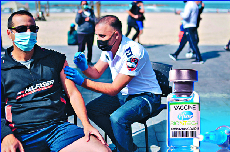 Israelis are vaccinated in Tel Aviv.