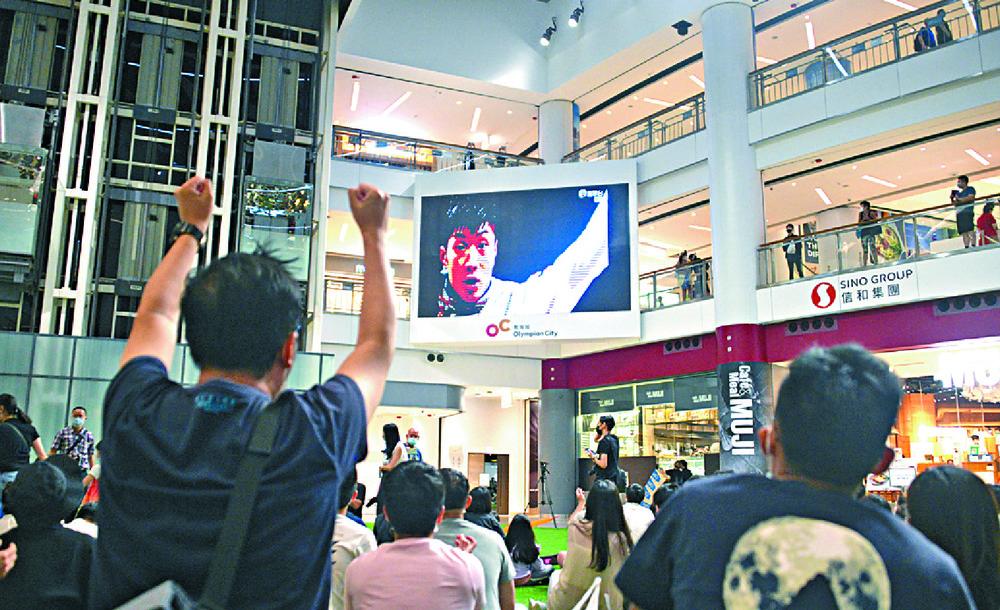 Thousands of Hongkongers packed shopping malls to cheer Cheung Ka-long on his way to Olympic history.