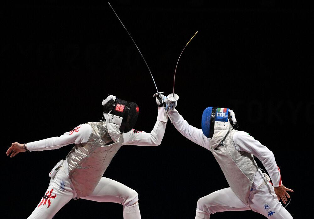 Cheung Ka-long, left, on his way to besting Rio Games champion Daniele Garozzo and hugging his coach.